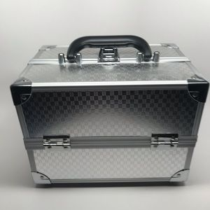 Silver make up case with keys to lock